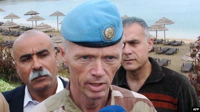 Syria -- The head of the UN observer mission in Syria, Major General Robert Mood, talks to local state-run television stations during a visit to the coastal city of Latakia in early May.