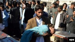 An injured child victim of a train accident is rushed to a local hospital in Quetta, Pakistan, on November 17.