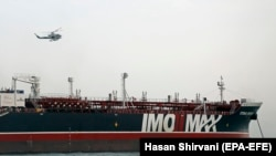 Iran's Revolutionary Guard chopper hovers around the detained British-flagged tanker Stena Impero in Bandar Abbas, July 21, 2019
