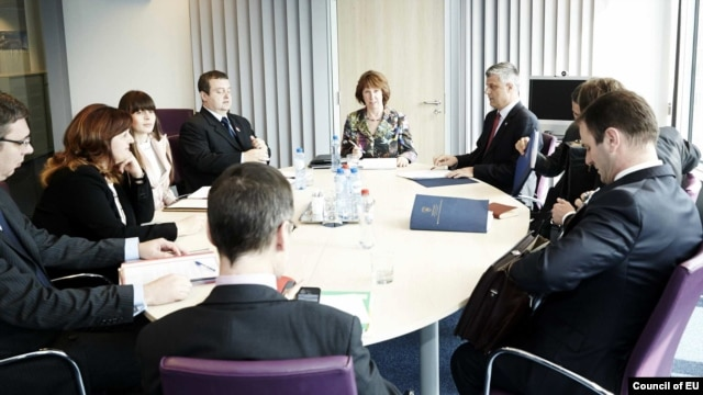 European Union foreign-policy chief Catherine Ashton (center) meets with Kosovar and Serbian delegations led by Hashim Thaci and Ivica Dacic, respectively, in Brussels on April 17.