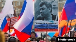 Russia – Russian people carry portraits, banners and flags during a memorial march for Boris Nemtsov to mark the second anniversary of his murder, in Moscow, Russia, 26 February 2017