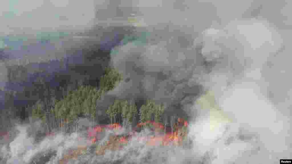 An aerial view shows a forest fire in the exclusion zone around the Chernobyl nuclear power plant on April 12. Ukraine's National Police said they had detained two people suspected of setting the initial fire.