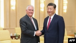 U.S. Secretary of State Rex Tillerson (left) shakes hands with Chinese President Xi Jinping in Beijing on September 30.