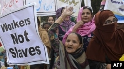Pakistani NGO activists and working women shout slogans during a rally held to mark International Human Rights Day in Lahore (file photo)
