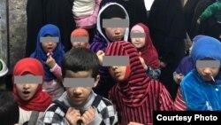 Таджикские женщины и их дети в Ираке.