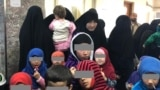 Tajik women and their children await their fate in an Iraqi court in January.