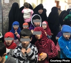 Tajik women and their children await their fate in an Iraqi court in January.