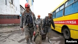 Employees walk near the Skochynskyy Mine outside Donetsk on April 11.