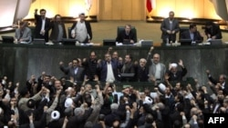 Members of parliament shout slogans calling for the execution of opposition leaders Mir Hossein Musavi and Mehdi Karrubi.