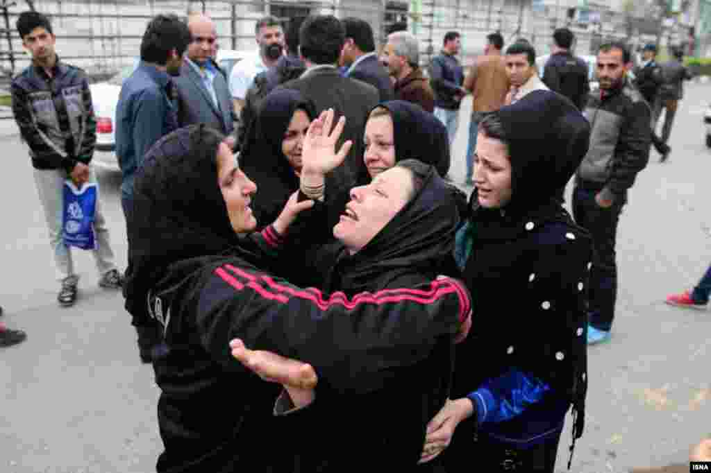 Relatives of Balal embrace. The pardon does not mean that he will be freed; the victim's family only have the right to call off the execution.