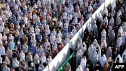 Iranian Muslims perform the Eid al-Fitr prayers at the Abdul Azim shrine in southern Tehran in June 2019.