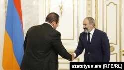 Armenian Prime Minister Nikol Pashinian (right) and Gagik Tsarukian, leader of the Prosperous Armenia Party.