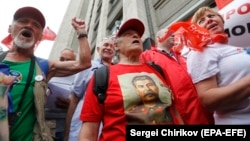 Russians protest in front of the State Duma against pension reform in Moscow in August.