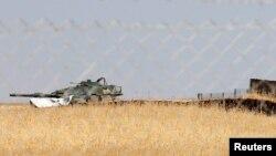 Pamje e një makine të blinduar turke në kampin Bashiqa