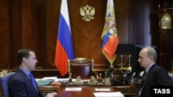 President Dmitry Medvedev (L) and Prime Minister Vladimir Putin meet in Medvedev's residence outside Moscow in June.