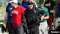 Співробітник спецназу на місці нападу, 14 червня 2017 року