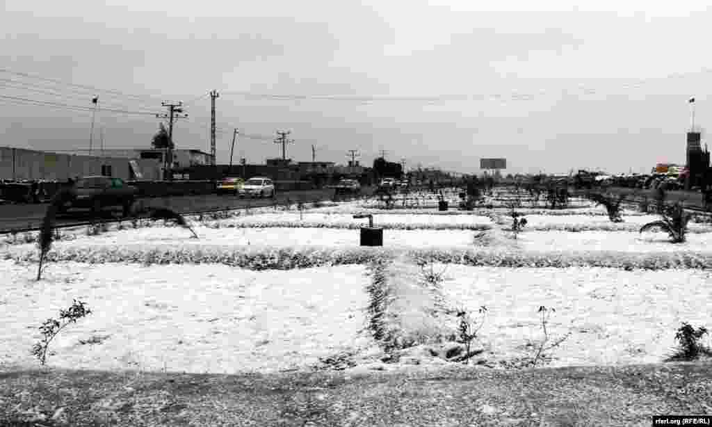 Snow covers a field in Kandahar, Afghanistan.