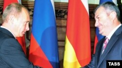 Is Russian Prime Minister Vladimir Putin (left) ready to welcome South Ossetia's Eduard Kokoity into his federation?