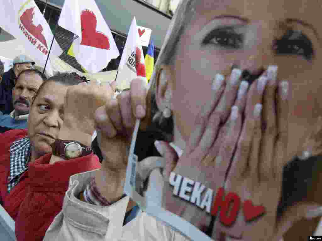 Tymoshenko supporters protest outside the Pecherskiy District Court in Kyiv on August 8, 2011.