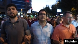 Armenia - Opposition activists Andrias Ghukasian (C), Armen Martirosian (R) and Davit Sanasarian lead an anti-government march in Yerevan, 29Jul2016.