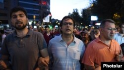 Armenia - Opposition leaders Andrias Ghukasian (C), Armen Martirosian (R) and David Sanasarian lead an anti-government march in Yerevan, 29Jul2016.