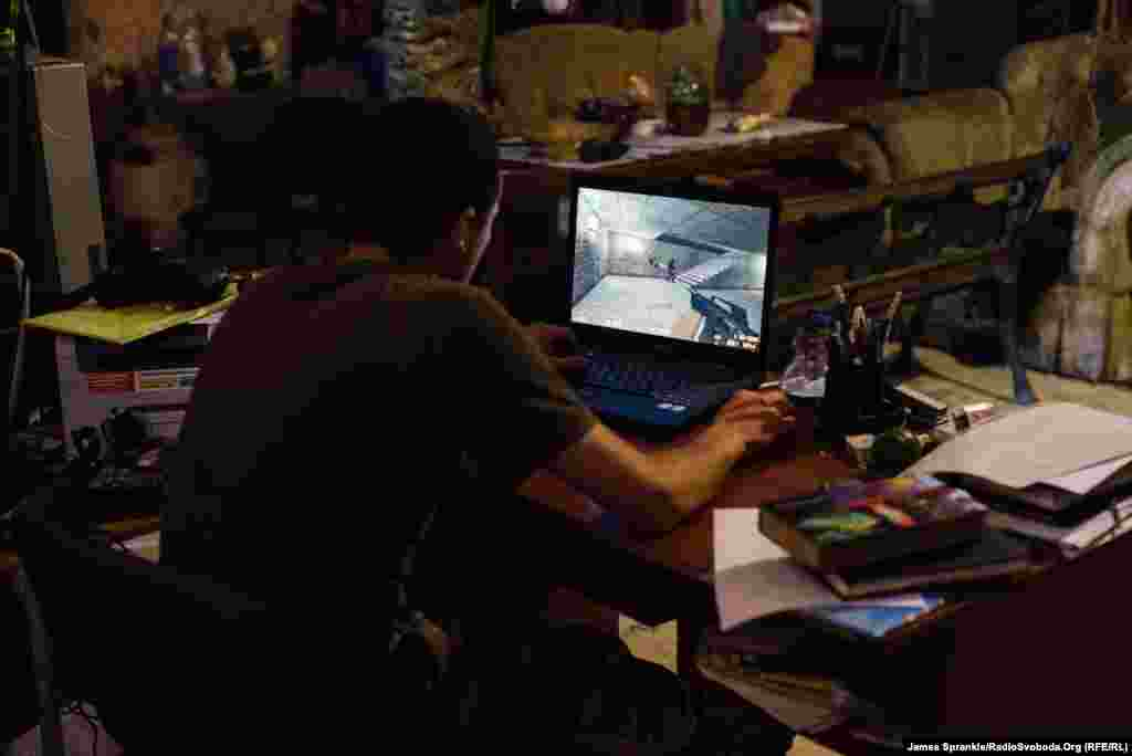 A young soldier from the 93rd Brigade plays a video game, Counter Strike, during a break.
