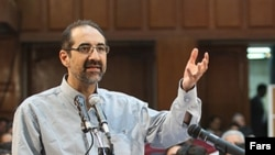 Iranian-American scholar Kian Tajbakhsh taestifies at his trial in August.