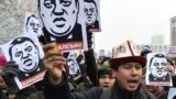 KYRGYZSTAN -- Demonstrators shout slogans and hold placards during an anti-corruption rally in Bishkek, November 25, 2019