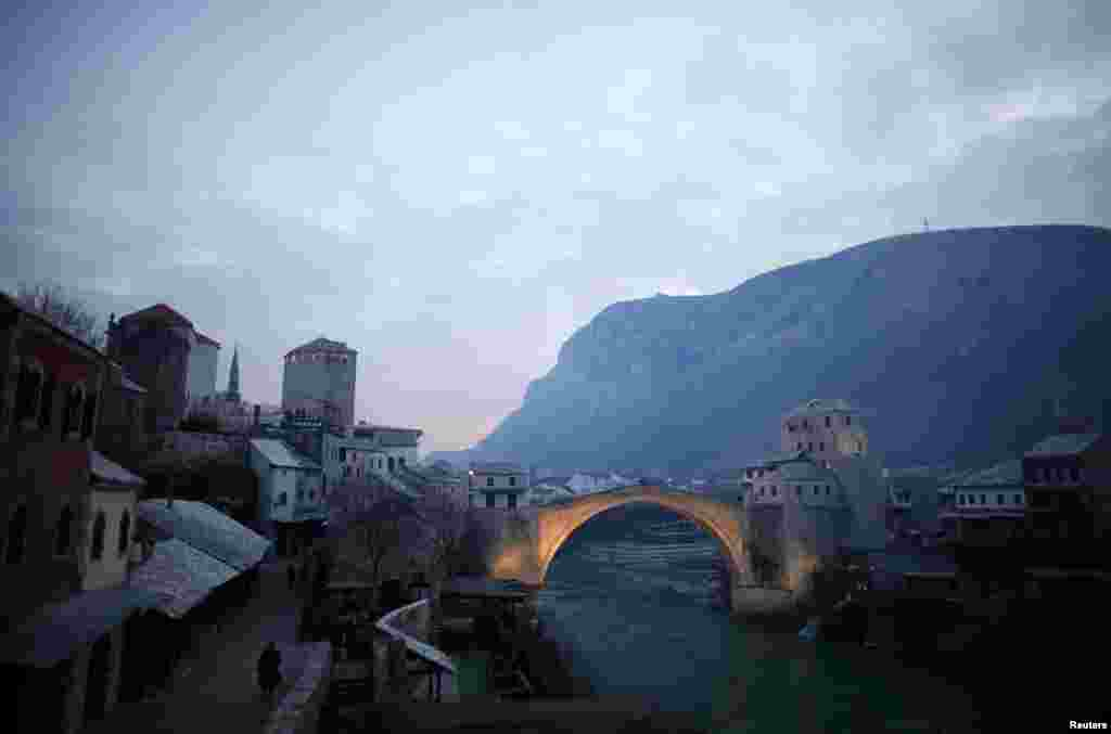 Mostar's old stone bridge over the Neretva River was destroyed in 1993 but rebuilt after the end of Bosnia's civil war in a move toward reconciliation.
