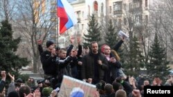 Pro-Russian demonstrators take part in a rally in front of the regional government building in Donetsk on March 5.