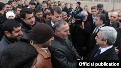 Armenia - President Serzh Sarkisian (R) talks to people in Armavir province, 13Jan2012.
