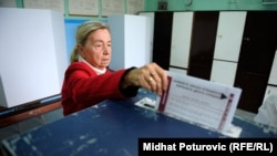 A voter casts her ballot in Sarajevo.