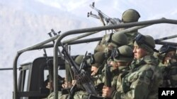 Turkish soldiers return from a mission near the Iraqi border