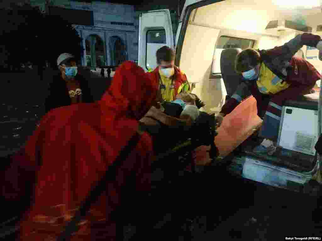 An injured person is attended to in an ambulance. More than 120 people were treated in Bishkek hospitals.