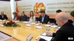 Candidates for mayor of Macedonia's capital, Skopje, sign documents.