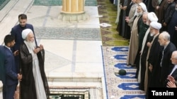 Tehran Friday Prayer Imam Ali Movahedi Kermani greeting dignitaries at the Friday Prayer ceremonies. September 20, 2019