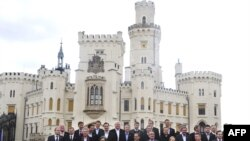 "EU foreign ministers pose for the ""family photo"" at the Hluboka nad Vltavou castle in southern Bohemia on March 27."