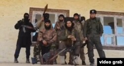 A photo of Tajik militants who reportedly took up arms in parts of Syria and Iraq. (file photo)