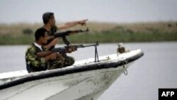 Iraqi coast guards patrol the waters of the Shatt Al-Arab waterway.