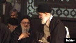 Ayatollah Seyyed Mohammad Mousavi-Khoiniha with Supreme Leader Ali Khamenei. Undated photo.