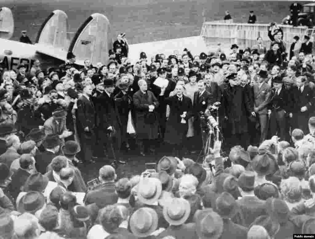 "In London on September 30, 1938, Neville Chamberlain holds up the paper containing the resolution to commit to peaceful methods signed by both Hitler and himself on his return from Munich. ""My good friends, for the second time in our history a British prime minister has returned from Germany bringing peace with honour. I believe it is peace for our time,"" he said."