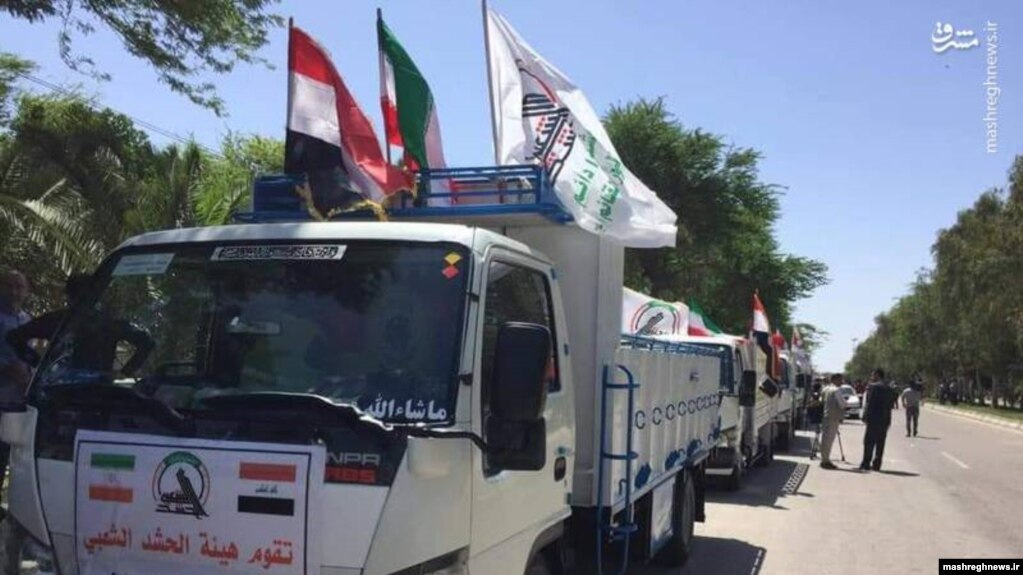 """Iraqi Shiite militia arriving vehicles in Iran's Khuzestan province """"to help in flood relief"""". April 11, 2019"""