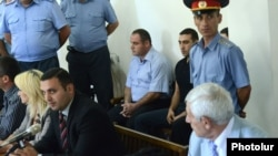Armenia - Two of the men charged with beating to death military doctor Vahen Avetian at the start of their trial in Yerevan, 13Sept2012.