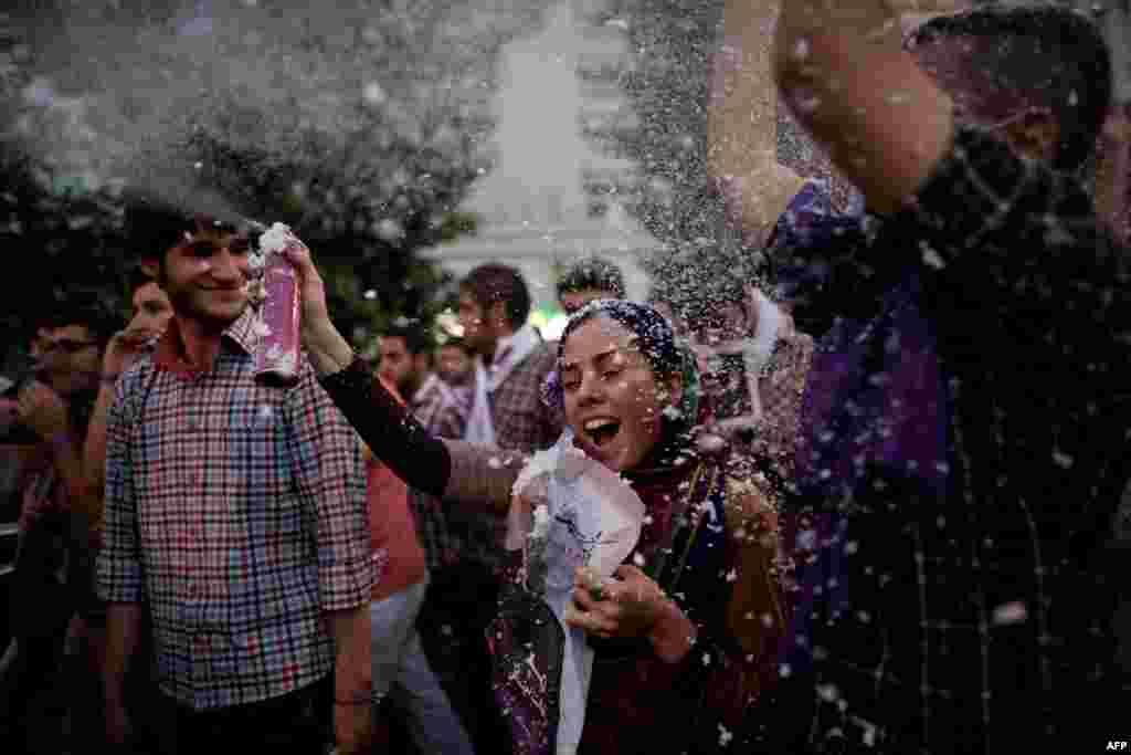 Celebrations along Vali Asr Street in Tehran after Rohani was declared the winner.