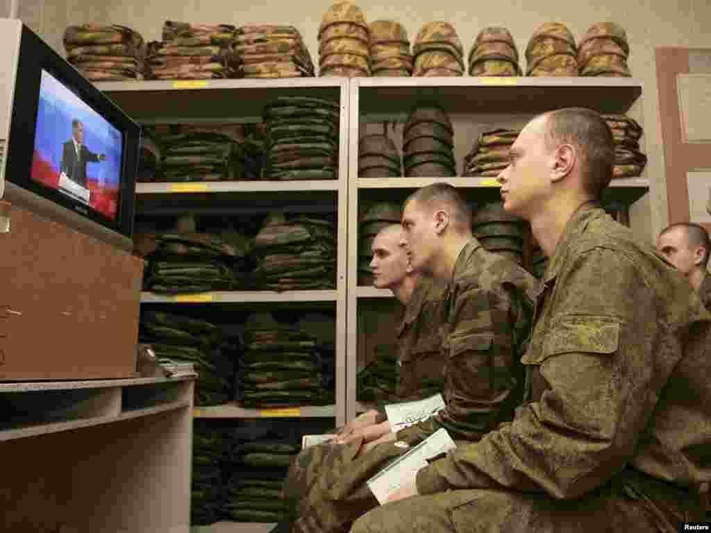 Servicemen of an infantry subdivision watch Russian President Dmitry Medvedev speaking during a press conference at the Skolokovo innovation center outside Moscow.Photo by Vladimir Konstantinov for Reuters