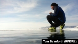 More than 100 people ran the marathon across Russia's Lake Baikal.