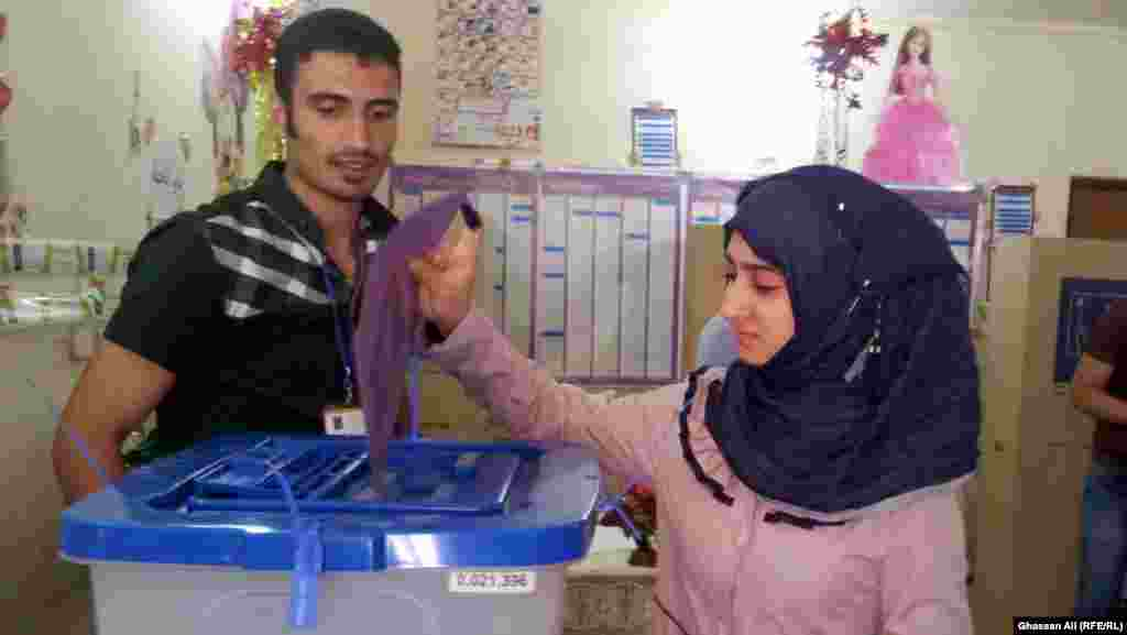 A young woman from Baghdad casts her ballot.