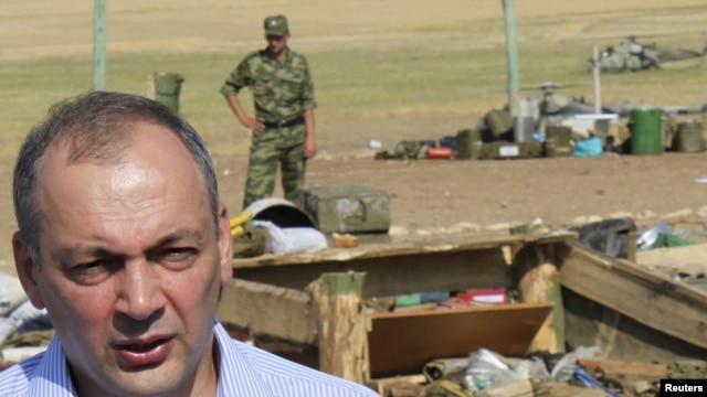 Daghestani President Magomedsalam Magomedov speaks to the media at a blast site in a military camp outside the town of Buynaksk in September.