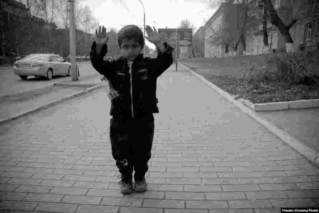 "Kurdish boy from Uzbekistan in Novosibirsk. From the series, ""Not Children's Fears, 2007."" Photo by Aleksander Bendyukov."