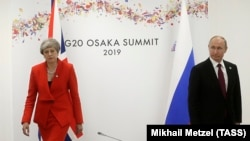 British Prime Minister Theresa May and Russian President Vladimir Putin meet on the sidelines of the G20 summit in Osaka.